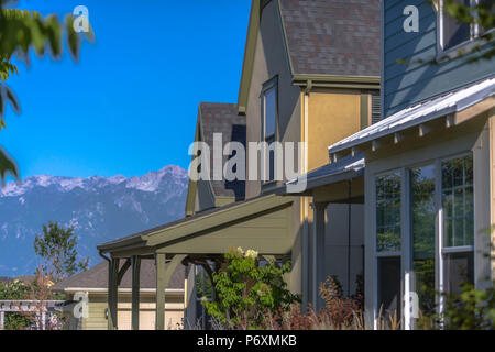 Beautiful model homes with mountains behind - Stock Photo