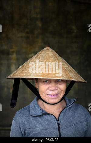Portrait of Woman with traditional conical hat , Hoi An , Vietnam - Stock Photo