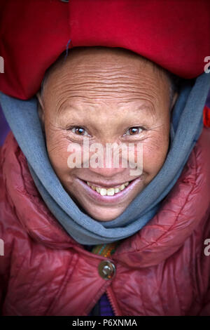 Red Dao smiling lady with turban in Sapa , Vietnam - Stock Photo