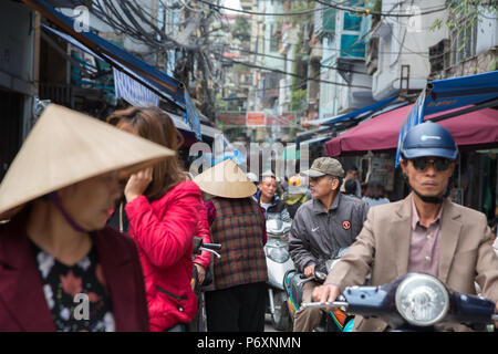 Crowd in a busy street of Hanoi , Vietnam - Stock Photo