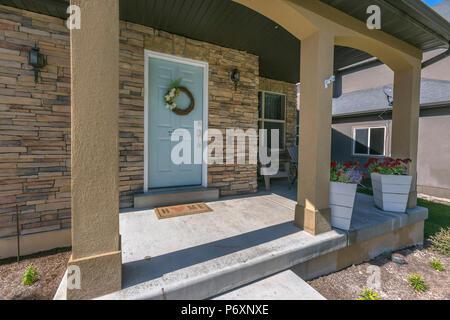 Blue front door with wreath - Stock Photo