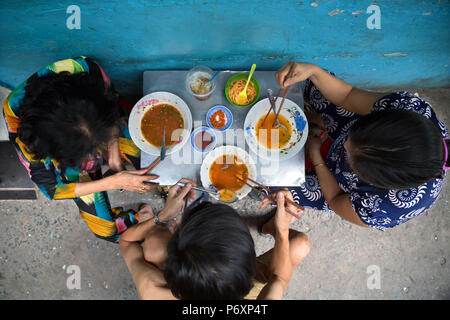 People eat tradition noodle soup called 'pho' in Saigon , Vietnam - Stock Photo