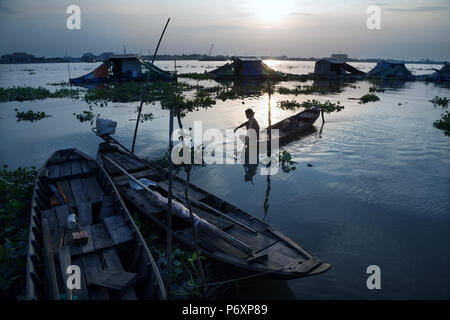 Amazing sunset landscape on Mekong river with boat from An Binh island , Vietnam - Stock Photo