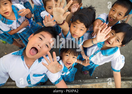 Kids with uniform  go crazy after school on An Binh island,Vietnam - Stock Photo