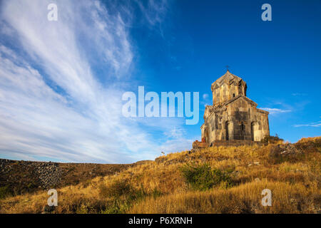 Armenia, Aragatsotn, Yerevan, Church of Surb Astvatsatsin also known as Vahramashen Church at Amberd fortress located on the slopes of Mount Aragats, with Mount Ararat in the distance - Stock Photo