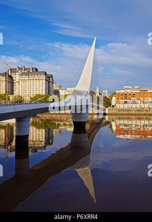 Argentina, Buenos Aires Province, City of Buenos Aires, View of Puente de la Mujer in Puerto Madero. - Stock Photo