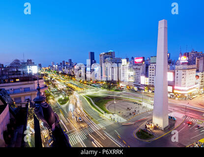 Argentina, Buenos Aires Province, City of Buenos Aires, Twilight view of 9 de Julio Avenue, Plaza de la Republica and Obelisco de Buenos Aires. - Stock Photo