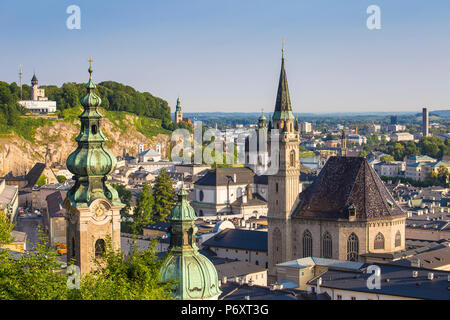 Austria, Salzburg, View of Old City, Petersfriedhof, St. Peter's Monastery and the Modern Art Museum on Mönchsberg hill - Stock Photo