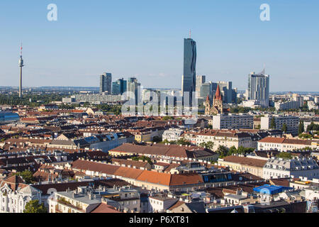 Austria, Vienna, View of city Skyline looking towards DC Tower at Donau City - to the left is the Donauturm - Danube Tower - Stock Photo