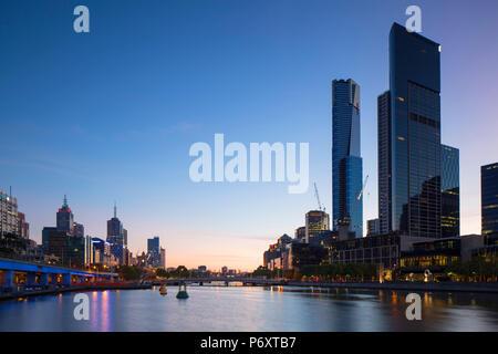Eureka Tower and skyline along Yarra River at dawn, Melbourne, Victoria, Australia - Stock Photo