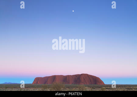 Uluru (UNESCO World Heritage Site) at dawn, Uluru-Kata Tjuta National Park, Northern Territory, Australia - Stock Photo