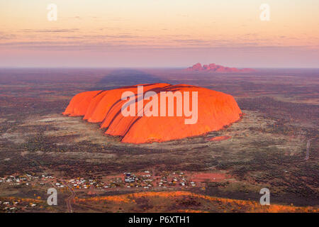 Uluru and Kata Tjuta at sunrise, Aerial view. Northern Territory, Australia - Stock Photo