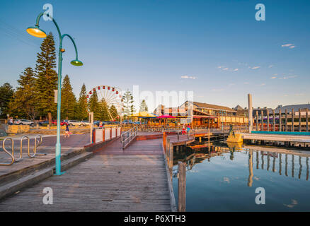 Fremantle, Perth, Western Australia, Australia. The waterfront of the Fremantle Harbour at sunset. - Stock Photo