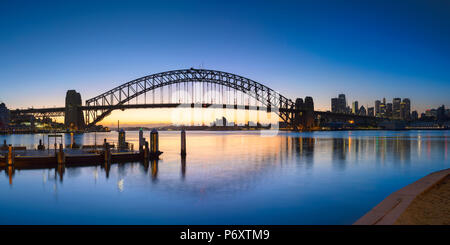 Sydney Harbour Bridge from McMahons Point at sunrise, Sydney, New South Wales, Australia - Stock Photo
