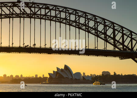 Sydney Harbour Bridge and Sydney Opera House at sunrise, Sydney, New South Wales, Australia - Stock Photo