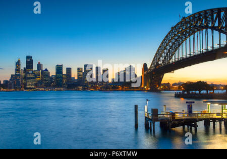 Sydney Harbour Bridge and skyline at sunset, Sydney, New South Wales, Australia - Stock Photo