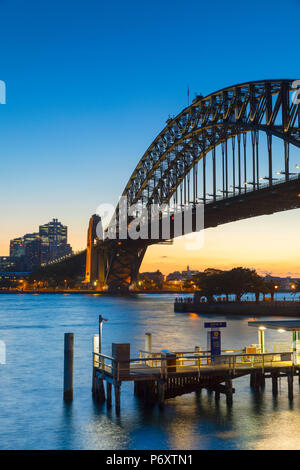 Sydney Harbour Bridge at sunset, Sydney, New South Wales, Australia - Stock Photo