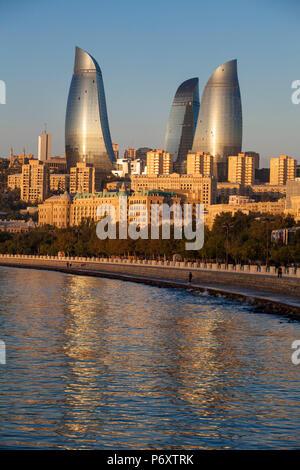 Azerbaijan, Baku, View of the Flame Towers reflecting in the Caspian Sea - Stock Photo