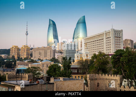 Azerbaijan, Baku, View looking over the walls of the old town to the Flame Towers - Stock Photo