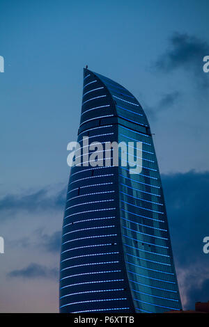 Azerbaijan, Baku, View of one of the three Flame Towers at dusk - Stock Photo