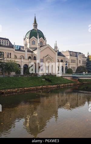 Bosnia and Herzegovina, Sarajevo, Festina Lente bridge leading to The Academy of Fine Arts, originally built as an Evangelical Church - Stock Photo