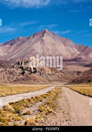 Bolivia, Potosi Department, Sur Lipez Province, Dirt Road and Cerro Lipez. - Stock Photo