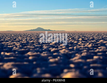 Bolivia, Potosi Department, Daniel Campos Province, View of the Salar de Uyuni, the largest salt flat in the world at sunset. - Stock Photo