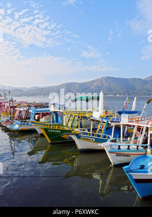 Brazil, State of Rio de Janeiro, Paraty, View of the colourful boats in the port. - Stock Photo