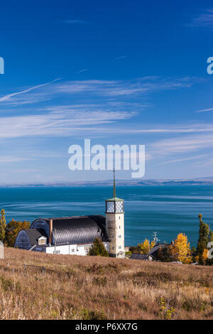 Canada, Quebec , Capitale-Nationale Region, Charlevoix, Cap-a-l'Aigle, village church and St. Lawrence River