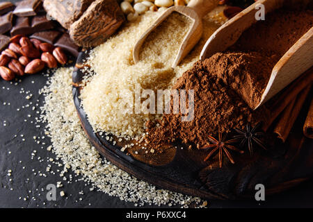 Cocoa powder, chocolate, nuts and spices - Stock Photo
