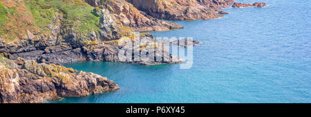 Panorama of the cliffs of the South coast, Guernsey - Stock Photo