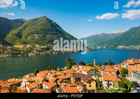 Torno, lake Como, Como province, Lombardy, Italy. High angle view of the town and the lake. - Stock Photo