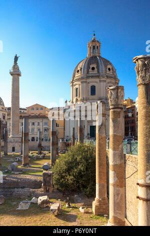 Italy, Rome, Traian forum along Fori Imperial street, with Santa Maria di Loreto church - Stock Photo