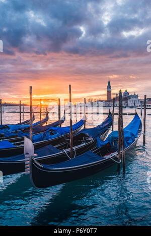 Venice, Veneto, Italy. Gondolas moored on Riva degli Schiavoni at sunrise. - Stock Photo