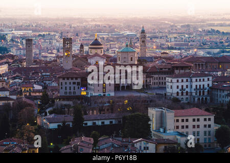 Bergamo, Lombardy, Italy. High angle view over Upper Town (Città Alta) at dusk - Stock Photo