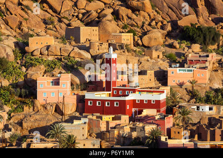 Elevated view over the Red Mosque of Adai, Tafraoute, Anti Atlas, Morocco - Stock Photo