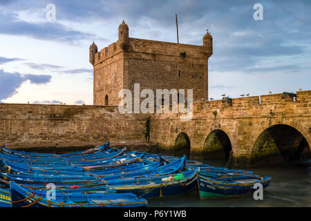 Morocco, Marrakesh-Safi (Marrakesh-Tensift-El Haouz) region, Essaouira. Skala du Port, 18th-century seafront ramparts on the fishing port at dusk. - Stock Photo