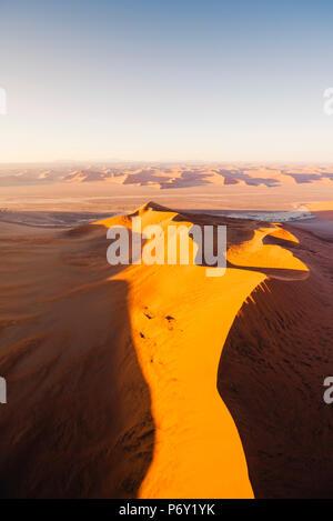 Sossusvlei, Namib-Naukluft National Park, Namibia, Africa. Aerial view of the sand dunes at sunrise. - Stock Photo