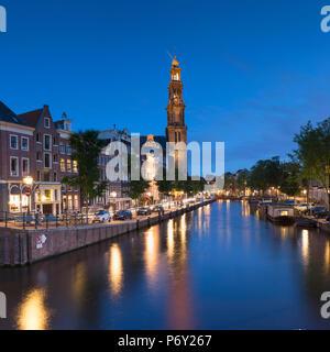 Prinsengracht canal and Westerkerk at dusk, Amsterdam, Netherlands - Stock Photo
