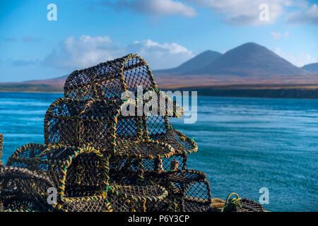 UK, Scotland, Argyll and Bute, Islay, Port Askaig with Isle of Jura, Paps of Jura mountains across Sound of Islay - Stock Photo