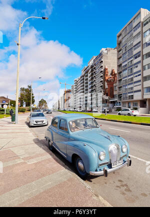 Uruguay, Montevideo, Vintage car parked by the Rambla. - Stock Photo
