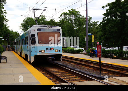 Light Rail train at Falls Road station on outskirts of Baltimore, Maryland, USA - Stock Photo