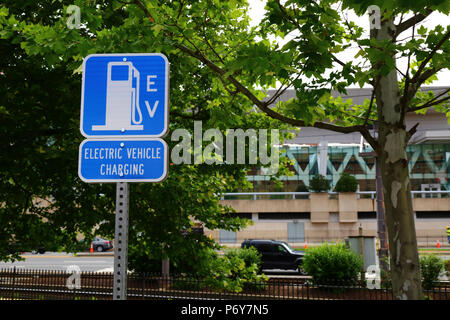 Electric vehicle charging station sign, Camden Yards, Baltimore, Maryland, USA - Stock Photo