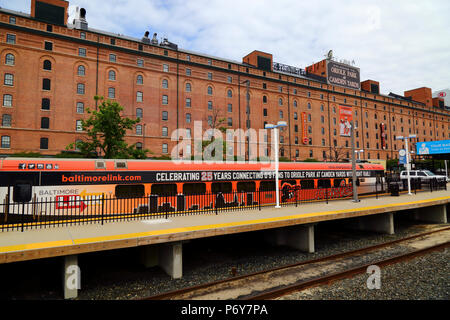 Light Rail coach painted to celebrate 25 years of Oriole Park (home of the Baltimore Orioles baseball team) at Camden Yards, Baltimore, Maryland, USA - Stock Photo
