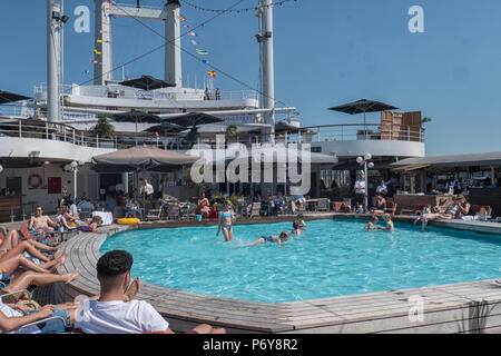 People at the swimming pool of a cruise ship - Stock Photo
