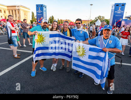 Samara, Russia - June 24, 2018: Football fans with flags of Uruguay in the fan zone at the central square - Stock Photo