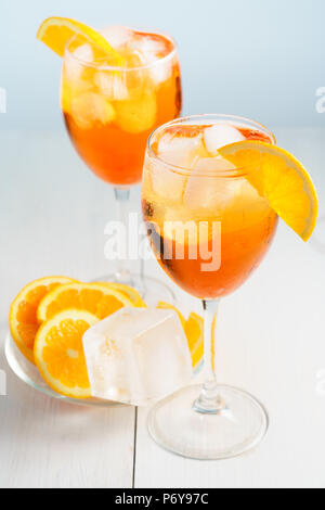 Aperol Spritz served with an orange slice in wine glasses. White background, high resolution - Stock Photo