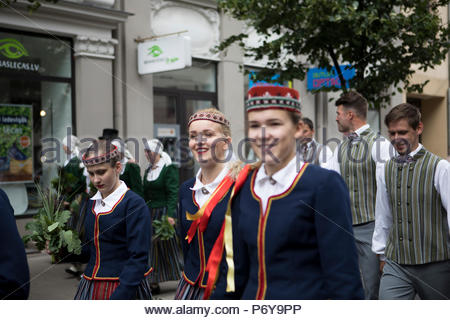 Regional groups during the annual Song and Dance festival in Riga on the 1st July. In 2018, Latvia also celebrates the 100th anniversary of its birth. - Stock Photo