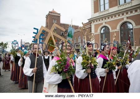 Regional groups parade the streets of Riga during the annual Song and Dance Festival on the 1st of July. Latvia also celebrates its 100th anniversary. - Stock Photo