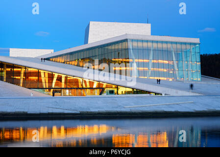 The Opera House, Norwegian National Opera and Ballet, by Snohetta architects in Bjorvika district, in the evening. Oslo, Norway - Stock Photo